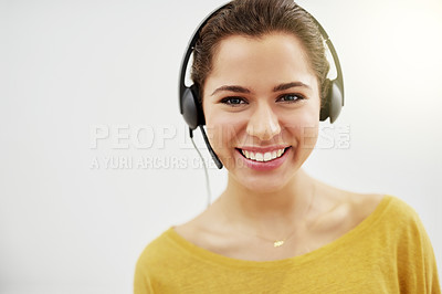 Buy stock photo Cropped portrait of a friendly call centre agent posing against a grey background