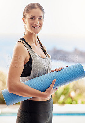 Buy stock photo Portrait of an attractive young woman carrying her yoga mat to class