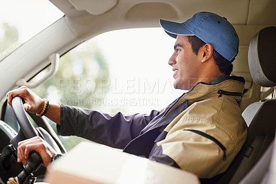 Buy stock photo Cropped shot of a delivery man driving in his van