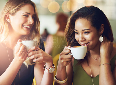 Buy stock photo Cropped shot of girlfriends enjoying their coffee at a cafe