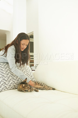 Buy stock photo Shot of a little girl playing with her cat