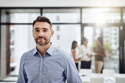Buy stock photo Defocused shot of a businessman posing with his colleagues in the background