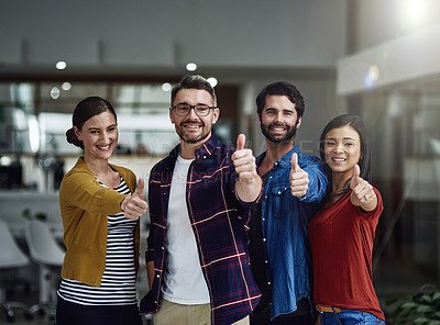 Buy stock photo Portrait of a group of businesspeople showing thumbs up