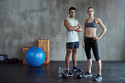 Buy stock photo Portrait of two young athletes standing with their gym equipment