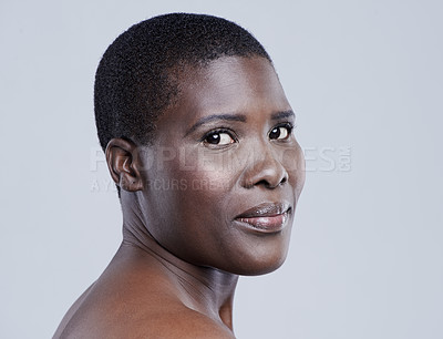 Buy stock photo Studio portrait of a beautiful african woman against a grey background