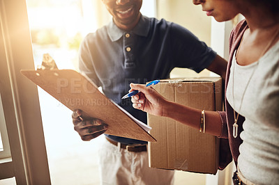 Buy stock photo Cropped shot of an unrecognizable woman signing for a home delivery