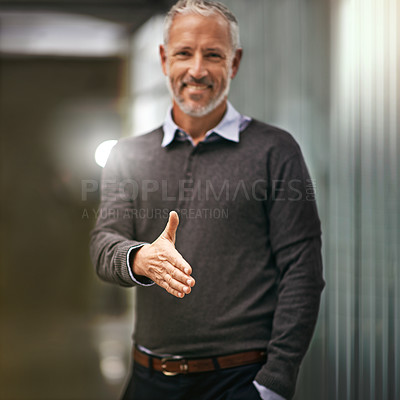Buy stock photo Portrait of a businessman gesturing for a handshake in an office