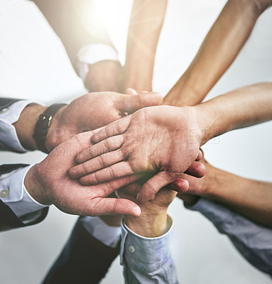 Buy stock photo Cropped shot of a team of colleagues joining their hands together in unity