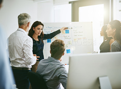Buy stock photo Shot of a group of business colleagues meeting in an office