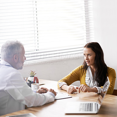 Buy stock photo Cropped shot of a doctor having a consultation with a patient in his office