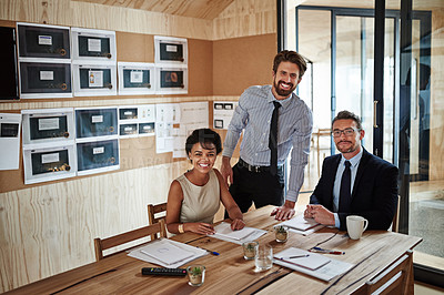 Buy stock photo Portrait of a group of colleagues working together around a table in an office
