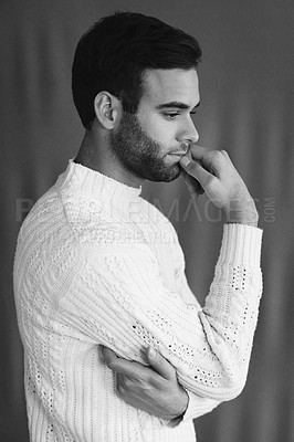 Buy stock photo Black and white shot of a handsome young man looking thoughtful