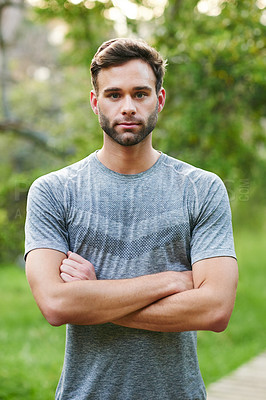 Buy stock photo Portrait of a sporty young man standing in a park