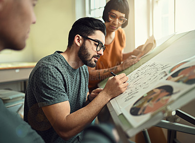 Buy stock photo High angle shot of a group of young designers working on a drafting table