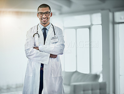 Buy stock photo Portrait of a young male doctor standing in a hospital