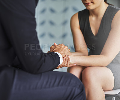 Buy stock photo Cropped shot of two compassionate colleagues holding hands