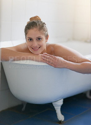 Buy stock photo Portrait of a beautiful young woman relaxing in the bathtub