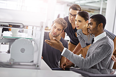 Buy stock photo Shot of a group of colleagues talking together about a 3d printer in an office