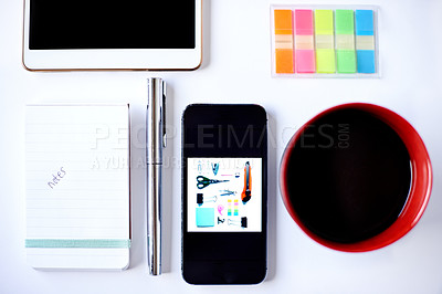 Buy stock photo High angle shot of stationery and smart devices on a table