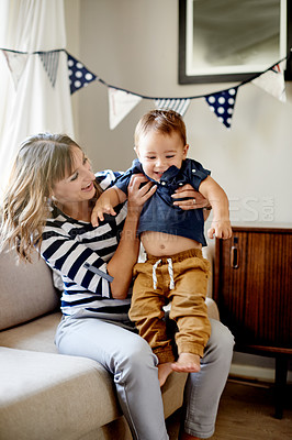 Buy stock photo Shot of a mother and son having fun on his first birthday at home