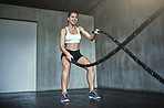 Work that waistline with a battle rope workout