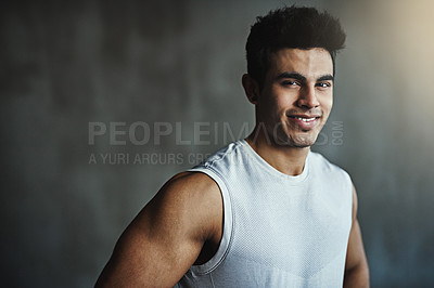 Buy stock photo Portrait of a sporty young man posing against a gray background