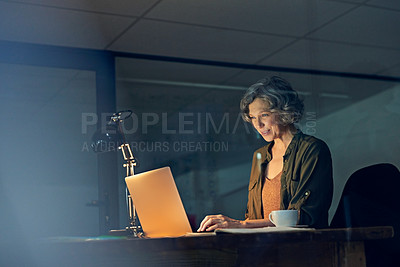Buy stock photo Cropped shot of a mature businesswomen working late on a laptop in an office