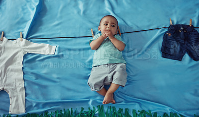 Buy stock photo Concept shot of an adorable baby boy hanging on a make believe clothes line
