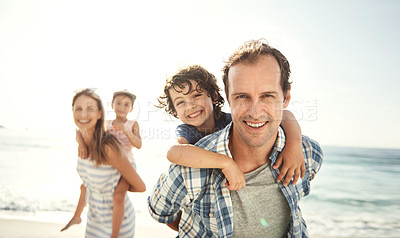 Buy stock photo Portrait of a happy young family having fun at the beach