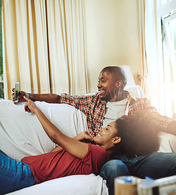 Buy stock photo Cropped shot of a young couple relaxing together at home