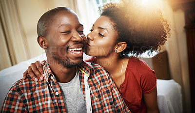 Buy stock photo Cropped shot of an affectionate young couple enjoying the day at home