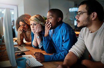 Buy stock photo Shot of a team of young businesspeople working late in the office