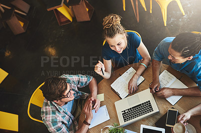 Buy stock photo High angle shot of a group of students studying in a coffee shop