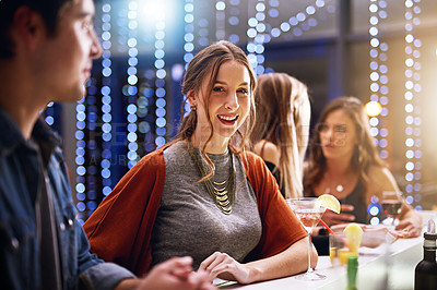 Buy stock photo Portrait of an attractive young woman standing in a nightclub