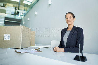 Buy stock photo Portrait of a well dressed receptionist waiting for a package to be collected form reception