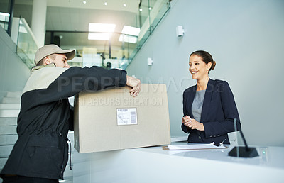 Buy stock photo Shot of a delivery man dropping off a package at an office