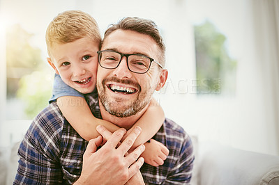 Buy stock photo Portrait of a father and his little boy bonding together at home