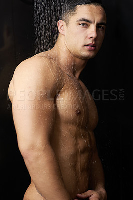 Buy stock photo Portrait of a handsome young man having a refreshing shower at home