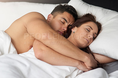 Buy stock photo Cropped shot of a young couple sleeping in bed together