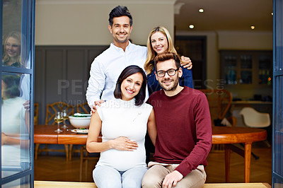 Buy stock photo Portrait of a group of young friends enjoying a get-together at home