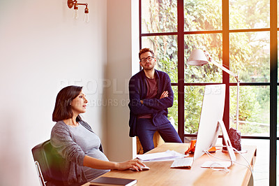 Buy stock photo Shot of an expecting couple working together in their home office