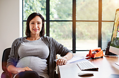 Buy stock photo Portrait of a pregnant woman sitting at a desk in her home office