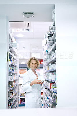 Buy stock photo Portrait of a pharmacist looking through the shelves at a chemist