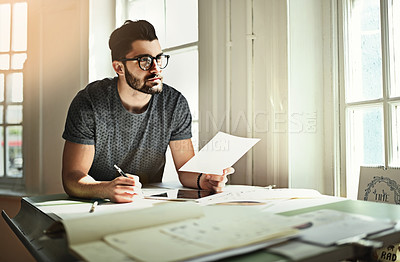 Buy stock photo Cropped shot of a handsome young designer working over a drafting table