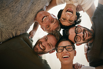 Buy stock photo Shot of a team of creatives huddled together in unity