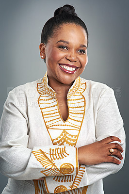 Buy stock photo Studio portrait of a confident woman dressed in traditional african attire posing against a gray background