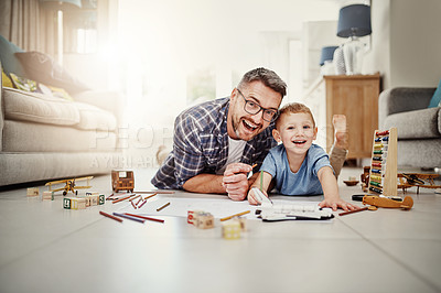 Buy stock photo Portrait of a father bonding with his son while drawing at home