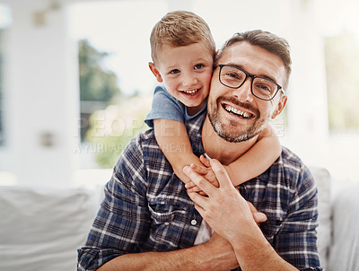 Buy stock photo Cropped portrait of a father bonding with his son at home