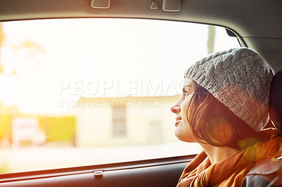 Buy stock photo Shot of a young woman looking through a car window while driving in Paris