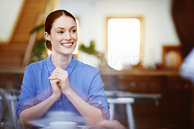 Buy stock photo Portrait of a smiling young woman sitting at a table in an office